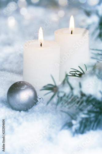 Candlelight in frosty snowy...