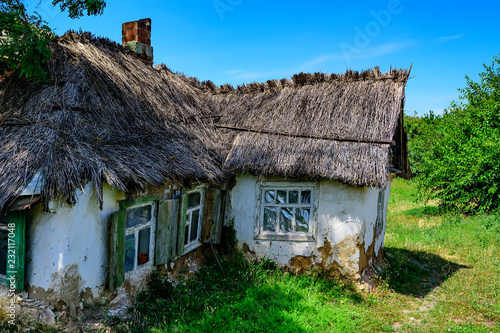 Old house in countryside with reed roof