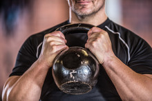 Strong Muscular Man Exercising With Kettlebell Facilities In Gym Or Workout Center