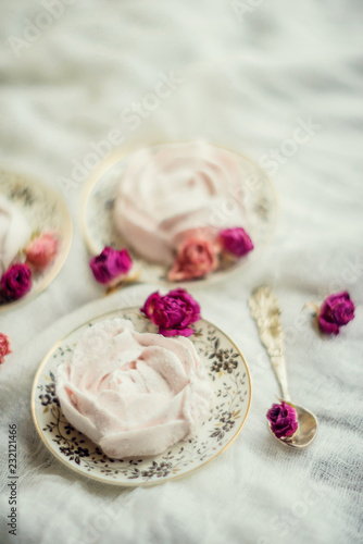 Fotografie, Obraz  Homemade marshmallow with fresh raspberries on a textile background with a Cup of coffee