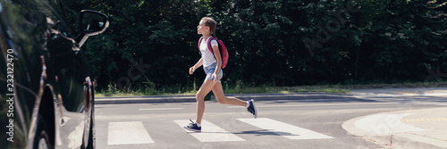 Panorama of car and girl running on pedestrian crossing to the school Fototapete