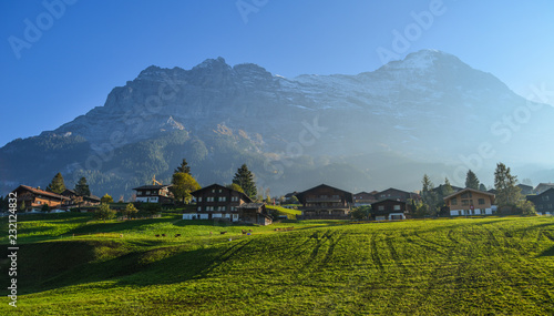 Landscape with mountain village in autumn