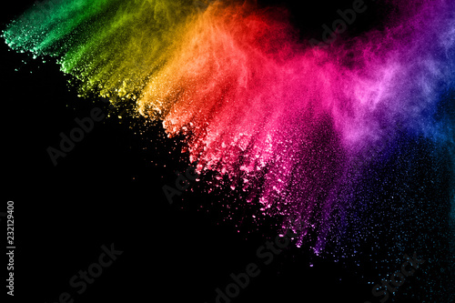 Obraz abstract colored dust explosion on a black background.abstract powder splatted background,Freeze motion of color powder exploding/throwing color powder, multicolored glitter texture. - fototapety do salonu
