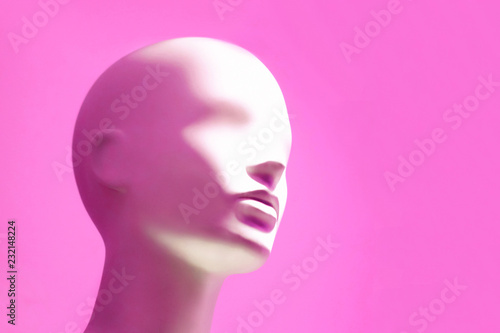 Head of white mannequin on pink background. Faceless girl. Fototapet