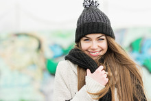 Gorgeous Young Woman In Knitted Hat And Scarf, Outdoors On Snowy Winter Day, Smiling. Closeup, Natural Lighting, Mild Retouch.