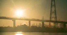Slow Pan Of Melbourne's Westgate Bridge At Sunset With The Sun Behind The Bridge.