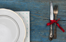 Empty White Ceramic Dish And Vintage Silverware On Wooden Background