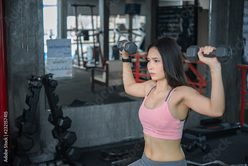 Foto op Plexiglas Fitness Beautiful asian woman play fitness in the gym,Thailand girl has a slim body,Time for exercise,People love heathy