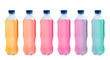 Set with different bottles of colorful drinks on white background