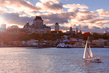 Old Quebec City At Sunset With Sailboat In Foreground
