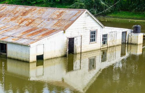 Valokuva  Flooded farm building