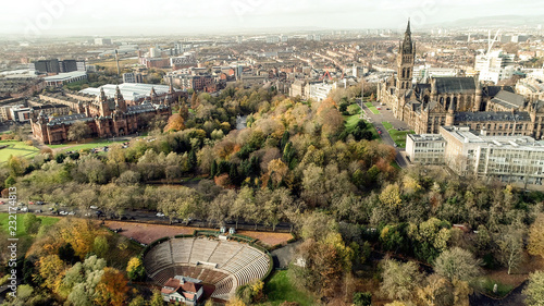 Photo Aerial image over the restored open air bandstand and amphitheatre in Kelvingrove Park, Glasgow, surrounded by autumn coloured woodland and the River Kelvin, to the Art Gallery and Museum