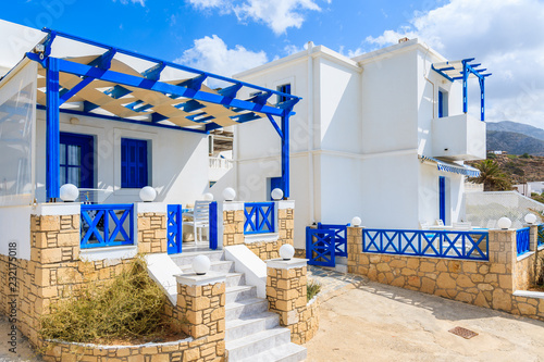 Typical Greek white and blue color tourist apartments in Lefkos village on Karpathos island, Greece
