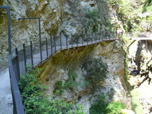 Dangerous Path At The Edge Of A Rock With Railing Overhanging In The Paper Mill Valley At Lake Garda