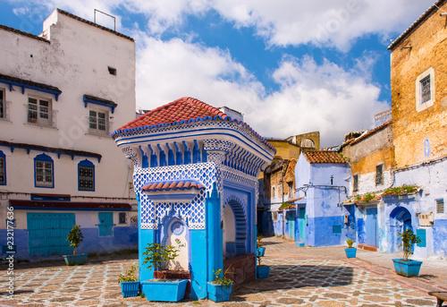 Poster Maroc Public fountain of the Plaza El Hauta, square in medina of Chefchaouen Morocco
