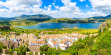 Panorama Of Zahara De La Sierra Village With Lake And Mountains In Background, Grazalema National Park, Spain