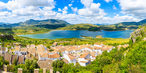 Fototapeta Panorama of Zahara de la Sierra village with lake and mountains in background, Grazalema National Park, Spain