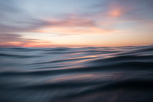 Low Angle View Of Sunset Over Ocean Waves