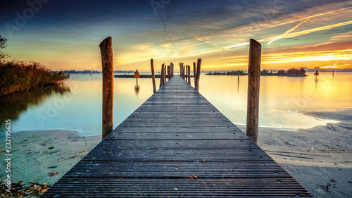 Architecture built walkway on the water with perspective, view art and calm water at sunny sunset