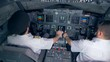 People piloting a plane in a simulator, top view.
