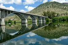 Bridge Reflections In Still River