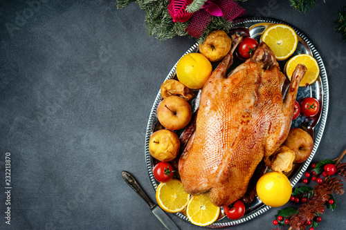 Christmas roasted whole goose on rustic table