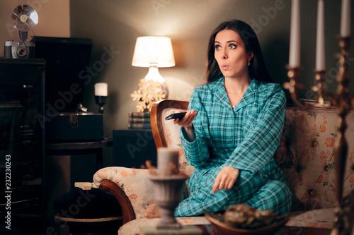 Fotografie, Obraz  Girl Wearing Pajamas Watching TV in her Room
