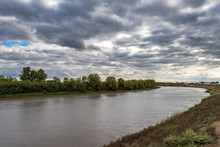 The Bed Of A Calm Plain River