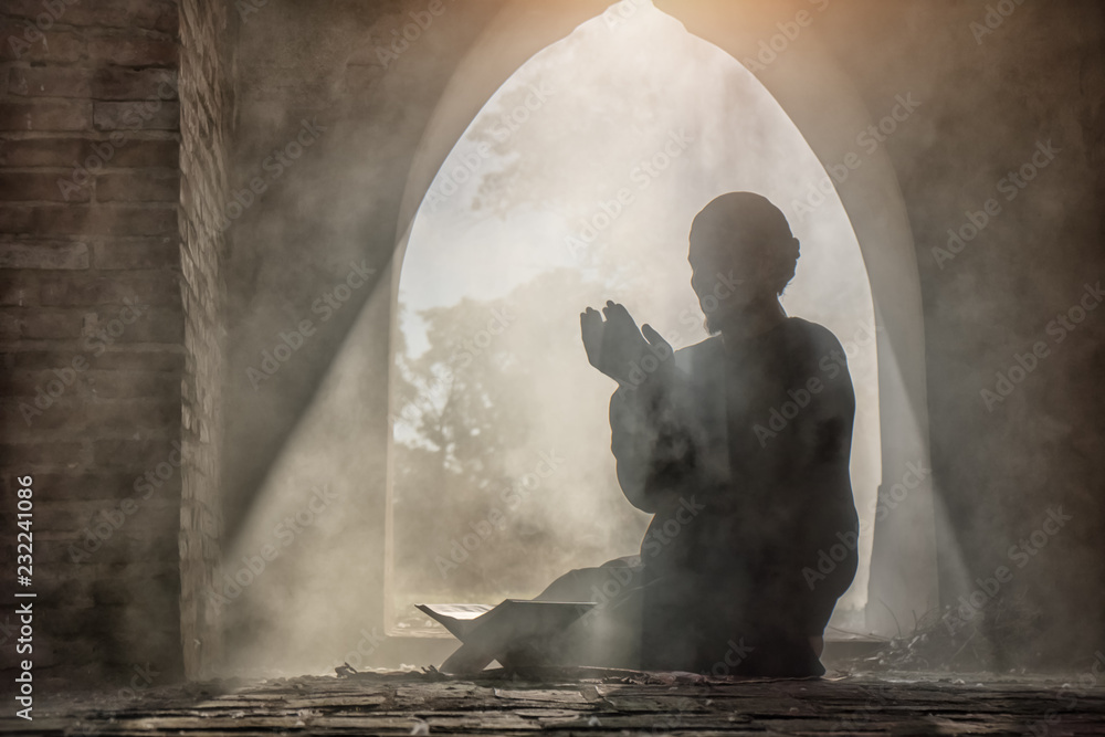 Fototapety, obrazy: Silhouette of muslim male praying in old mosque with lighting and smoke background