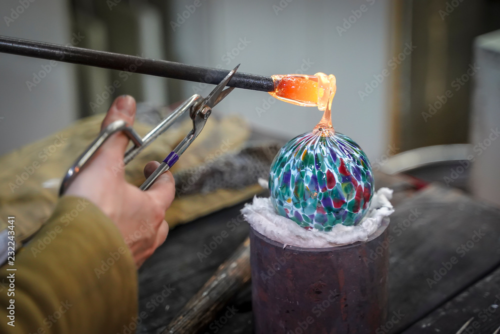 Fototapety, obrazy: A Beautiful Glass Ball Being Made by a Glass Blower