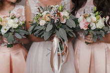 Bridesmaids And Bride Holding ...