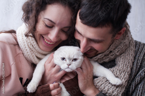 Photo  Couple Taking Playing With Pet Cat At Home
