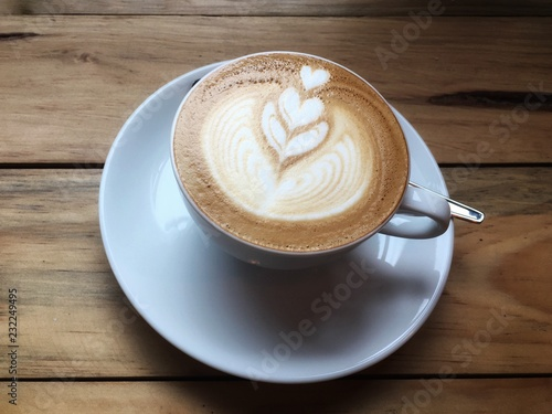 Hot Cuccino Coffee In White Cup And Saucer With Spoon On