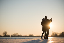 Romantic Couple Dancing On Frozen Lake