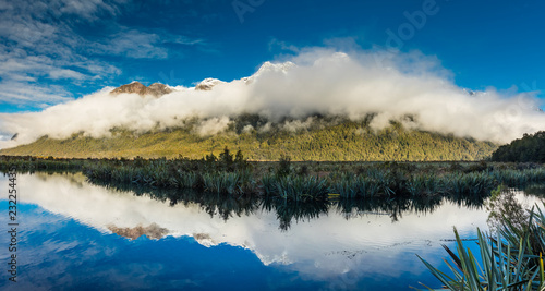 Fotobehang Oceanië Mirror Lakes with reflection of Earl Mountains, Fjordland National Park, Millford, New Zealand