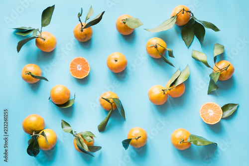 Fresh mandarin isolated on blue punchy pastel. Top view. Fruits pattern.