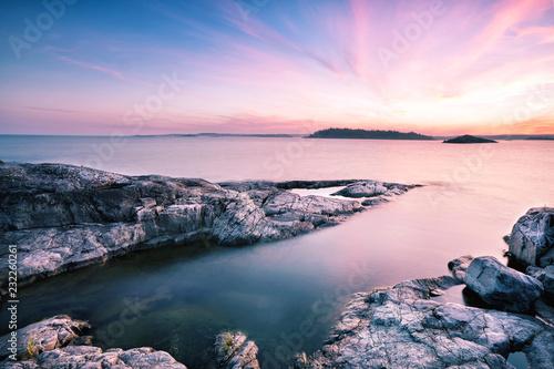 Staande foto Lichtroze Textured stone island under dawn sky