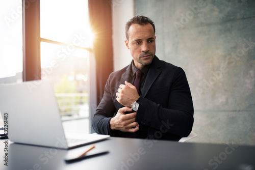 Pensive businessman working with a laptop in office