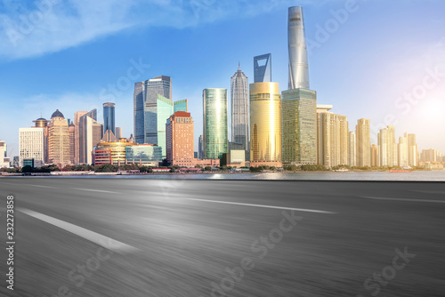 Empty asphalt road along modern commercial buildings in China's cities Wallpaper Mural