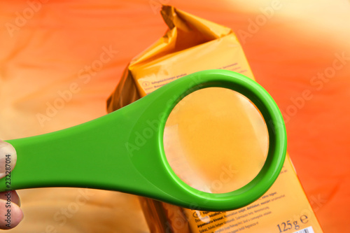 Fotografie, Obraz Empty magnifying glass on food additives label with copy space for your text