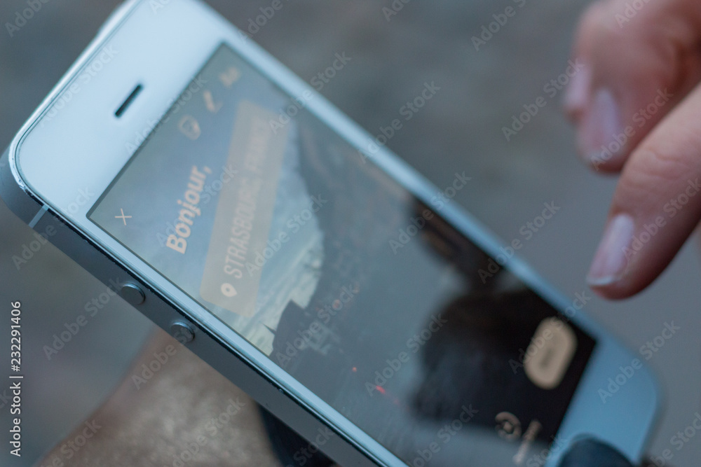 Fototapety, obrazy: Close-up of mobile phone display with a story saying Bonjour Strasbourg