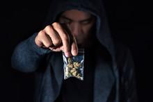 Young Man With A Bag Of Marihuana Buds