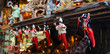 Leinwanddruck Bild - Statues of pulcinella lucky charm and red horns at the souvenir shop in Naples