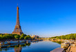 canvas print picture View of Eiffel Tower and river Seine at sunrise in Paris, France. Eiffel Tower is one of the most iconic landmarks of Paris
