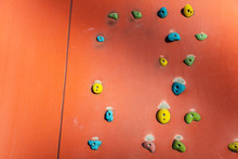 Rock Climbing Or Bouldering Wall With Colourful Hand Holds