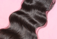 Body Wavy Black Human Hair Weaves Extensions Lace Closure Upon Pink Background