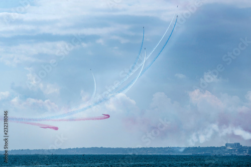 Colourful aerobatics demonstration above sea