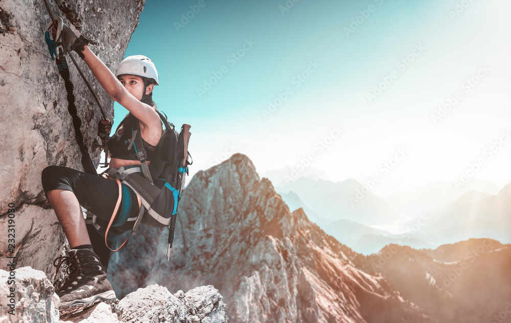 Fototapety, obrazy: Young woman climbing in the alps