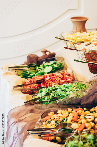 Deurstickers Assortiment Fresh Salad and Light Snack Trays on a Buffet