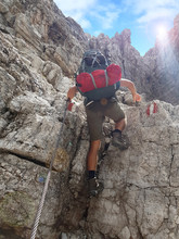 Hiker With Backpack Climbing A...